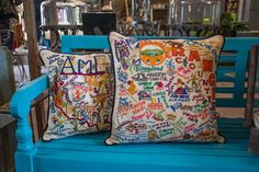 How can you not have one of these hand-stitched pillows! I've been resisting the urge...  http://rogersgardens.com/home-decor/