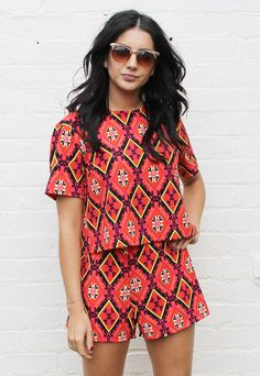 - Burnt orange base with red, yellow, black & cream accents - On trend folk tile print - Boxy tee style top with short sleeves & high wais...