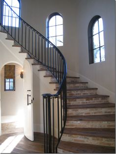 octagon house entry w/ brick staircase + iron balister + arched windows
