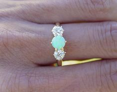 Vintage opal and diamond engagement ring. I wish the diamond was in the middle and then the opal on the sides Ring Set, Ring Verlobung, Hand Ring, Bling Bling, Kelsey Rose, Jewelry Box, Jewelry Accessories, Jewlery, Big Jewelry