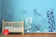 Deep Sea Wall Decals for Baby Nursery. Underwater themed nursery decor. Squid starfish jellyfish lobster seaweed seagrass decal stickers. $143.00, via Etsy.