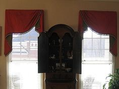 Board mounted Moreland valances with contrast lining and decorative tassel trim