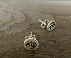A simple tiny pair of earrings handmade from sterling silver for all yoga lovers! Minimalist Jewelry, Arrows, Sterling Silver Earrings, Om, Studs, Charms, Stud Earrings, Unique Jewelry, Handmade Gifts