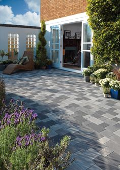 Block paving isn't just a great looking solution for driveways.  Here our StoneMaster provides a distinctive and eye-catching patio.