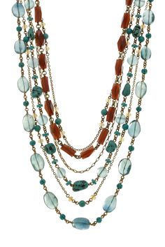 Make a dramatic statement with this authentic Stephen Dweck necklace. $530 Polished turquoise stones and faceted horn create a beautiful color contrast that enhances the eclectic design. Pair this necklace with a simple black maxi dress and wedges for a bold dressy-casual look.