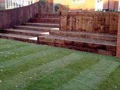 Lawn with raised bed- done with railway sleepers