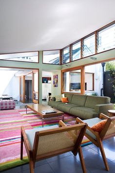 Birchgrove House modern-living-room. Love this sage gum leaf green, especially with the warm wood trim.
