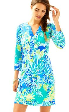 The 3/4 sleeve Riva Dress has a notched neckline, side slits, gold buttons on the sleeve, and is a comfortably chic way to incorporate print into your day. Put on this cotton dress and walk over to your favorite breakfast spot, then head over to the cabana and hop in the hammock for a little disco nap.
