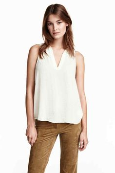 Sleeveless chiffon blouse with an opening at the front with a gold-coloured button at the top, a frill trim at the neck and a slightly longer bac Sustainable Clothing, Sustainable Fashion, Paris Outfits, Chiffon Blouses, Kids Fashion, Womens Fashion, Blouse Styles, My Wardrobe, Blouses For Women