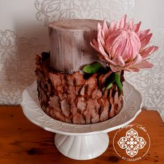 Beautiful bark effect on this 2 tier wedding cake decorated with a handmade sugar Protea on the side 2 Tier Wedding Cakes, Wedding Cake Decorations, How To Make Cake, Cake Designs, Cake Decorating, Sugar, Desserts, Handmade, Beautiful
