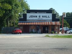 This is John Hall Store. The building that now houses the store was originally constructed in 1913 and is a popular gathering spot, grocery store and BBQ restaurant today. Until 1986, the building also contained the Cecil, AL post office. Located at the intersection of AL-110 and Flowers Road, it is a popular staging area for bicycle rides through the scenic rural parts of eastern Montgomery County.