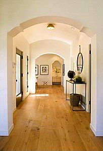 LOVE the archways, the wood floor and the white wall palette!