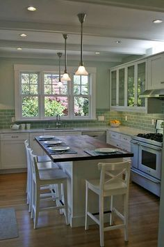 Communal setups top list of new kitchen trends A rustic wood-covered island doubles as a place to dine in this Craftsman-style kitchen featured on Small Farmhouse Kitchen, Diy Kitchen Island, Modern Farmhouse Kitchens, Rustic Kitchen, New Kitchen, Home Kitchens, Kitchen Backsplash, Backsplash Ideas, Farmhouse Design