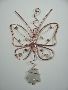 Items similar to Copper wire butterfly ornament sun catcher, seaglass and Swarovski crystal, upcycled on Etsy - Copper wire butterfly ornament suncatcher by metamorphosea - Butterfly Ornaments, Wire Ornaments, Snowman Ornaments, Wire Crafts, Jewelry Crafts, Handmade Jewelry, Earrings Handmade, Wire Wrapped Jewelry, Wire Jewelry