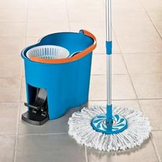 "Microfiber Spin Mop. Bought similar ""double spin mop"" at the LA County Fair 2012, called ""Miracle Mop:  Just pump and spin"" with a double bucket that spins to clean the mop then spins it dry in basket.  It's FANTASTiC.  There's a lever on the handle you push down to spin and up to mop.  Pop head off and wash in washing machine with detergents but never bleach which breaks down the microfiber material. Made in China, from Canada.  360 degree spin and 90 degree mop movement (to the floor) :)"