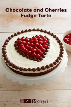 This delicious Chocolate and Cherries Fudge Torte makes for a great weekend recipe. Made with HERSHEY'S Cocoa and HERSHEY'S MINI KISSES Brand Milk Chocolate, this is a lovely cherry-pie-inspired chocolate dessert. Bring this cake to Thanksgiving dinner or serve it to guests this holiday season.