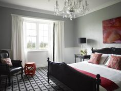 greg Natale white dado rail grey walls patterned carpet red accents bedroom