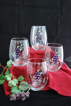 """Stemless, Hand-Painted Wine Glasses make the best gift! Our glorious Wine Festive hand painted wine glasses are a great delight at any party. These Stemless wine glasses hold 5""""h and can hold 18oz. You can special order this also in Green, burgundy grape design at no extra charge. We can also mix colors. Only $38.00 for a set of four!"""