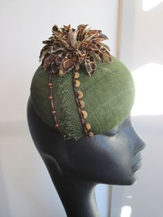 Green tea sinamay cocktail hat with wood beads and giraffe flower. MindYourBonce by Karen Geraghty