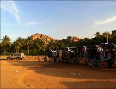 Here are ten things to do in Hampi, Karnataka, India. Boulders devour the barren land and every extra inch is filled with temples and palm trees. India Travel Guide, Hampi, Karnataka, Jurassic Park, Goa, Bouldering, Palm Trees, Things To Do, Country Roads