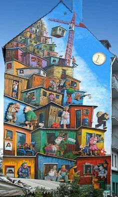 A cartoon city on a city building (complete with colorful characters). ARTE callejero.