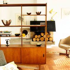 This mid-century modern cabinet is used to great effect as a room divider.