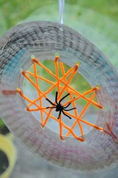 Paperplate and yarn spider Web with a plastic ring spider!