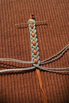 Silver wire braided around deerskin thong. Kobolds Kerkerbastelei: