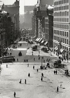 New York City in 1903. Street cleaners out dodging the traffic.