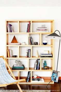 Accent your books with decorative objects for a stylishly organized bookshelf.
