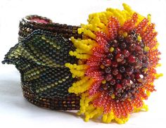 Beaded Sunflower accessory to put on lots of things - I favor napkin rings for my tablescapes.