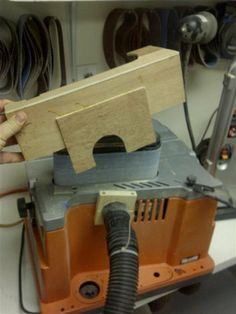 This isn't much of a project, but I think it is a beneficial accessory to the RIGID oscillating belt sander that I believe many of you LumberJocks may have (I've seen it in many photos posted on LumberJocks). By adding this simple dust hood, the . Workshop Design, Workshop Ideas, Woodworking Shop Layout, Woodworking Ideas, Shop Dust Collection, Wood Projects, Projects To Try, Dust Collector