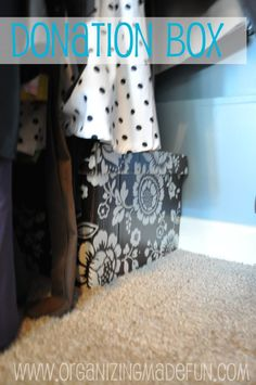 In the back corner, I tucked a small donation box under my dresses. If I notice I haven't been wearing something very much or I just don't like how it fits me, I toss it in the box. If I really miss it {which I don't think I've ever had happen}, I can pull it back out. But, when the box is full, I have a friend I give the clothes to.