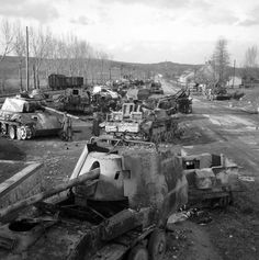 Abandoned Panzers of all types litter the roads during the retreat back into Germany