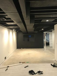 How to basement stairs storage tips Black painted exposed basement ceiling Unfinished Basement Ceiling, Old Basement, Industrial Basement, Basement House, Basement Plans, Basement Stairs, Basement Black Ceiling, Painted Basement Ceilings, Basement Workout Room