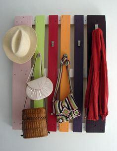 This just looks like the top of a pallet painted...another frugal way to hang things and add color to a room.