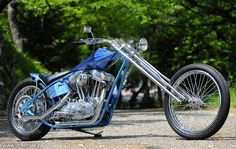 Evo Sporster hardtail custom digger with skinny extended springer, prism tank and blue monotone metal flake paint job Digger, Choppers, Evo, Helmets, Old School, Tanks, Harley Davidson, Motorcycles, Boards