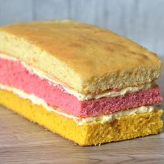 The classic British layered sponge loaf. Pink, yellow and plain, sandwiched together with buttercream. There's nothing like an Angel Cake! Sandwich Cake, Sandwich Recipes, Sandwiches, Golden Syrup Cake, Cheese And Onion Pie, Sultana Cake, Baking Recipes, Cookie Recipes, Baking Cupboard