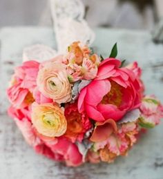 Pink and peach peony ranunculus bridal bouquet from featured vendor  ‏ @Kay Carmen Kravchuck. Lovely!