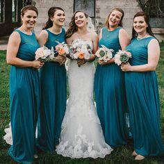 Jordan's bridesmaids in beautiful Oasis blue illusion neckline gowns from David's Bridal | Photo instagram/jordansuplee13