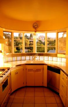Art Deco kitchen in round room 1940's- Glass block behind the sink!