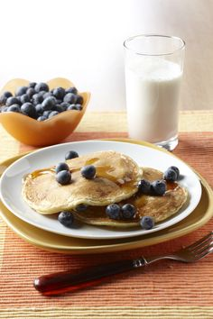 Father's Day breakfast idea: a plate of griddle cakes with a blueberry infusion and a glass of milk on the side!