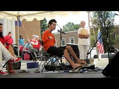 George Dennehy was born without arms but, it doesn't stop him from playing his guitar! Here he is at the 2012 Strawberry Faire in Ashland, Va.