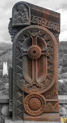 khatchkar also referred to as Armenian cross-stones is a carved, memorial stele bearing a cross, and often with additional motifs such as rosettes, interlaces, and botanical motifs.  The oldest khachkar with a known date was carved in 879 A.D. Erected in Garni, it is dedicated to queen Katranide, the wife of king Ashot I Bagratuni. The peak of the khachkar carving art was between the 12th and the 14th centuries.