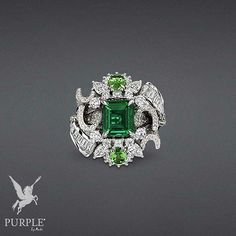 "Be radiantly elegant with this white gold ""Plumetis Émeraude"" ring with diamonds, emerald, and tsavorite garnets. Loving emeralds more and more with these amazing creations by Dior. (=)"