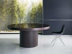Berkeley round dining table features pedestal wood base finished in exotic Brazilian veneer, with painted glass top. Measures 71 dia x 30 (base 31.5 dia). Table edge measures 3 inches, leaving 27-inch clearance. Seats 8-10 guests. Glass top 4mm thick standard (non-tempered) glass. Made in Brazil. Imported.