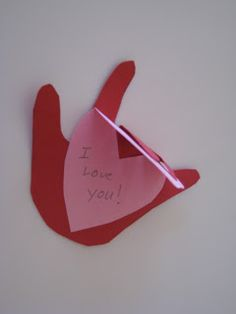valentines card idea...trace child's hand, glue two fingers to a heart shaped insert...cute!