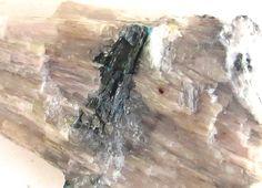 Mendipite, Pb3Cl2O2, Merehead Quarry (Torr Works), East Cranmore, Somerset, UK. Creamy crystalline columnar mendipite with dark greenish chloroxiphite and minor blue diaboleite and paralaurionite