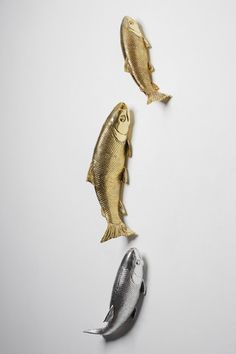 Interior Illusions Set Of 3 Koi Fish. Add a bold accent piece to your home using the Koi Fish Wall Decor. Finished in metallic silver and gold, these 3D resin fish make a unique statement on a living room or bedroom wall. Keyholes in the back allow for easy hanging and mounting