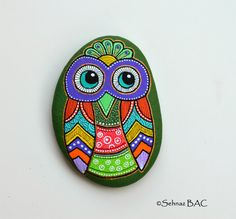Hand Painted Pebble Owl / Beach pebble with hand-painted designs in acrylics  © Sehnaz Bac 2014    I paint and draw all of my original